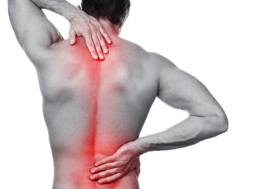 Man with pain in his back over white background